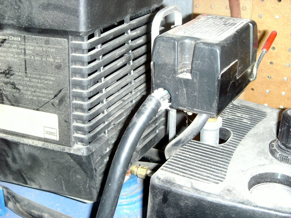 This air compressor needs some work where the wire enters the control box; it will eventually be damaged from vibration if not clamped properly.