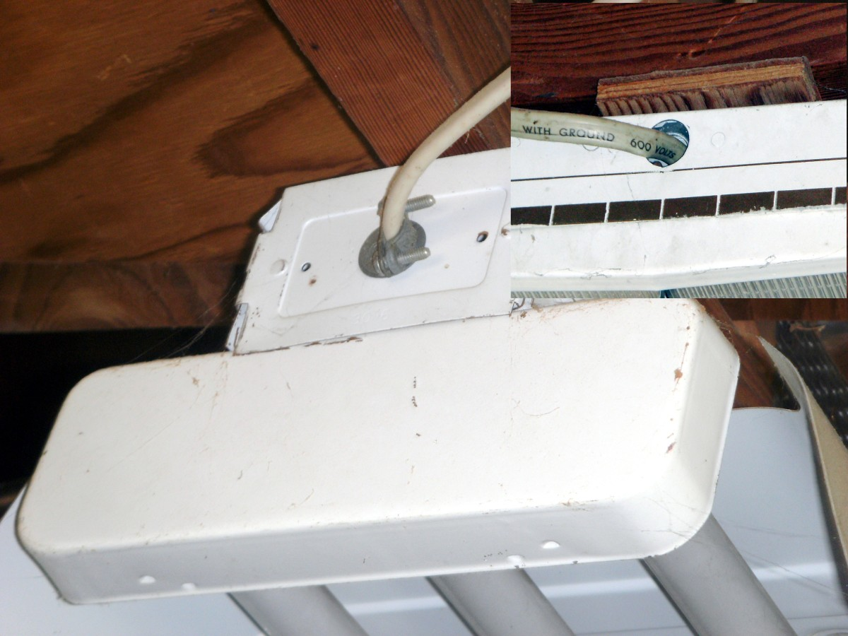 A properly wired shop fixture.  The inset photo shows one without a cable clamp; the wire will eventually be cut by the sharp edge of the fixture.