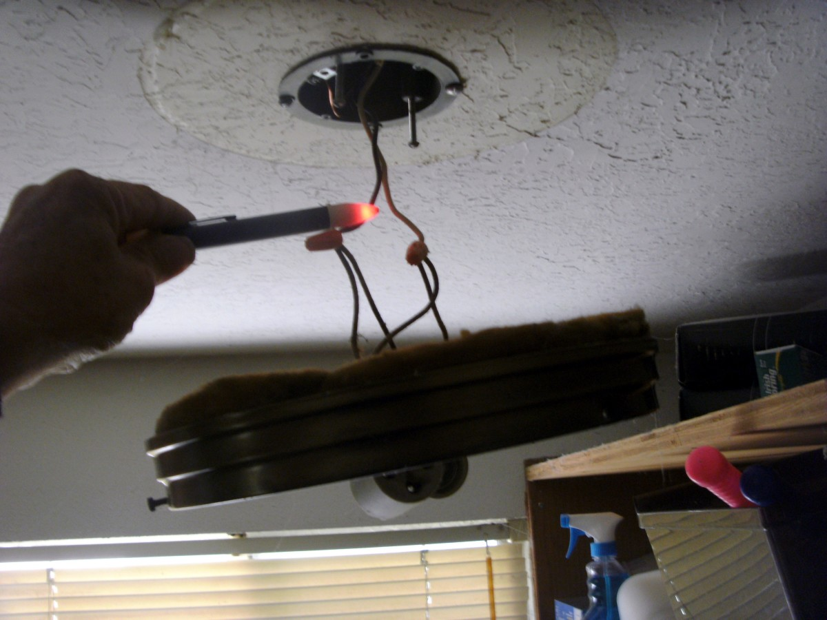 Changing this flickering light fixture found the old wire to be charred at the ends of the wires with both wire nuts loose.  A fire waiting to happen.