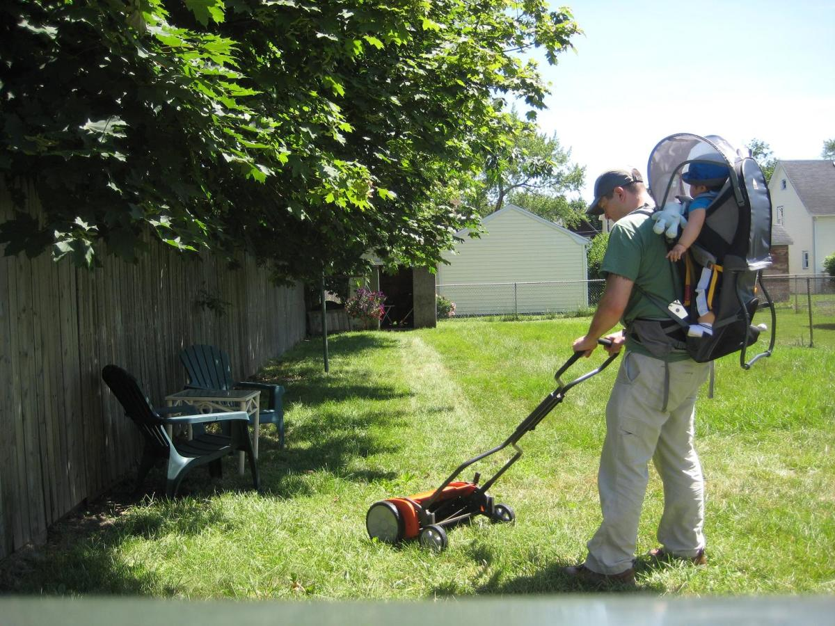How safe is a reel mower?  I mow the grass with my son on my back.