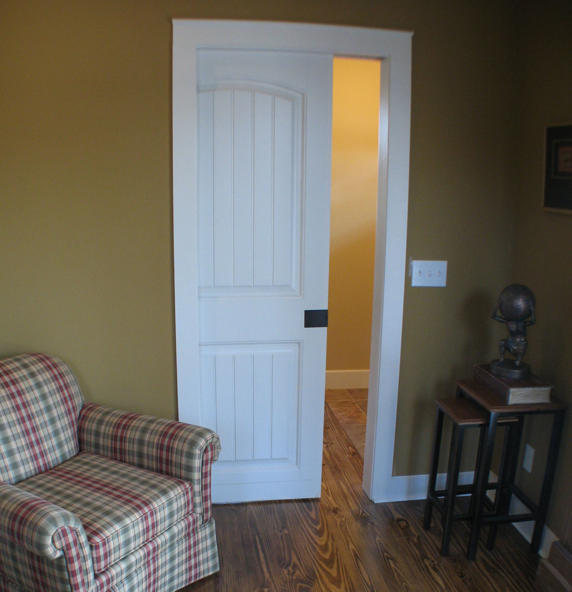 This small study saves space with a pocket door and avoids conflicting with the front door on the other side of the wall.