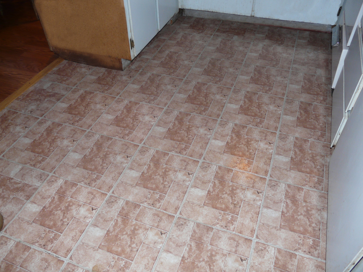 Finished peel and stick vinyl tile floor