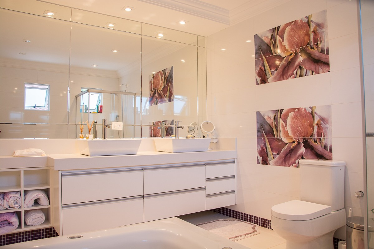 Bathroom Mirrors Over Windows sizing the mirror above your bathroom vanity | dengarden