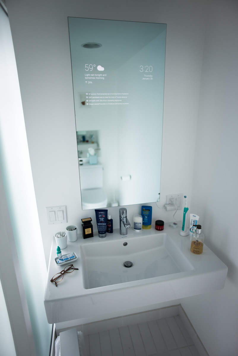 Magic mirror: modern technology allows this mirror to show you much more than just your reflection.