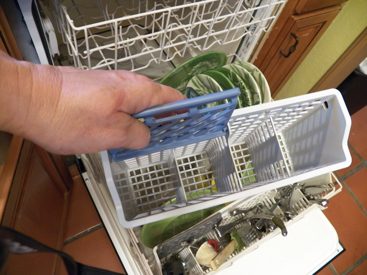 Original silverware basket has four slots.  My old one also fit in and I kept it like many people on reviews suggested. However, I eventually decided to use the one that came with the washer and put bigger items in the top rack.