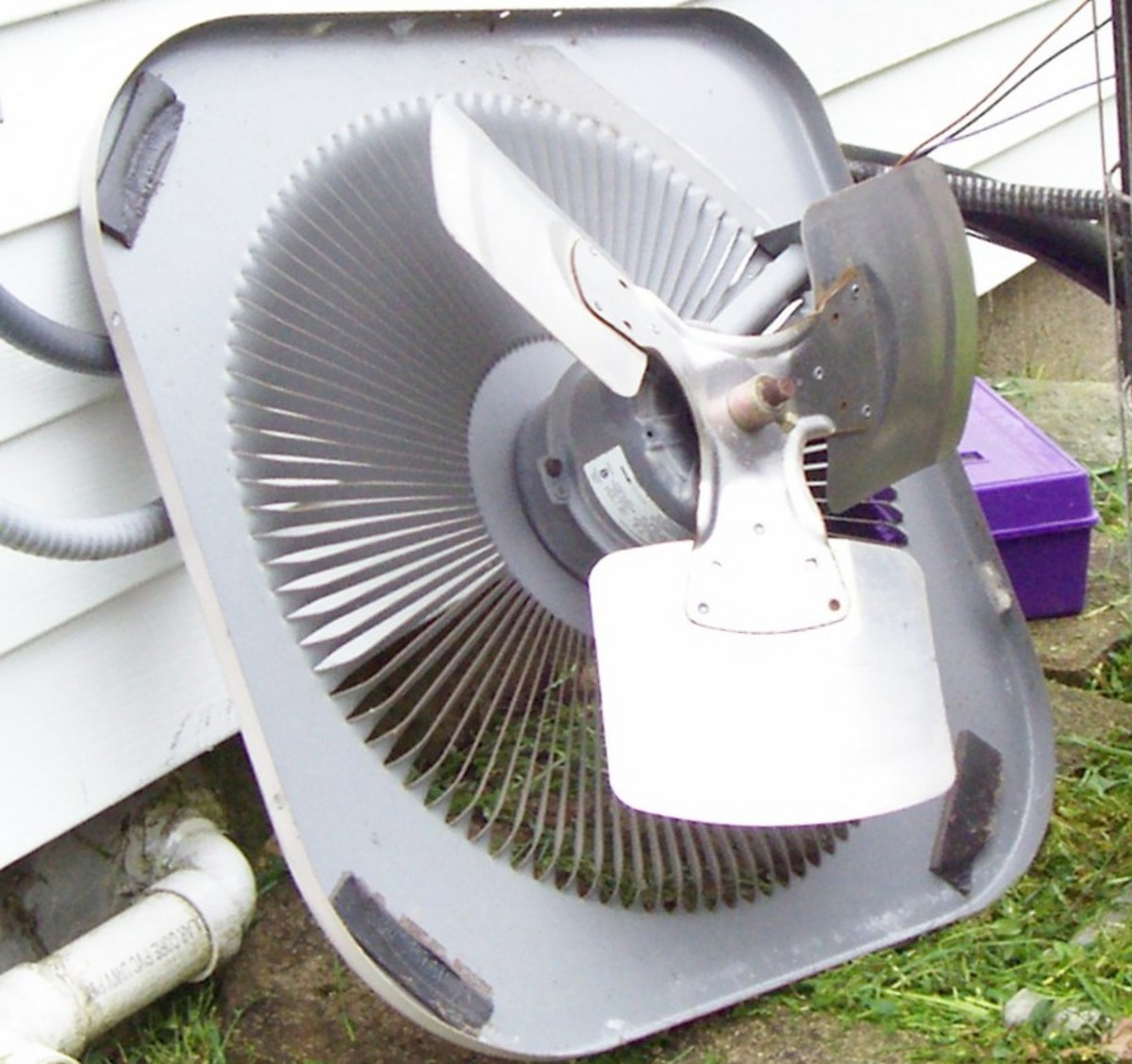 Here the condenser lid is removed so that you can see the fan and motor. Notice the solid housing on the motor. Be sure your fan spins freely with your hand and if not, lubricate the shaft so that it does.