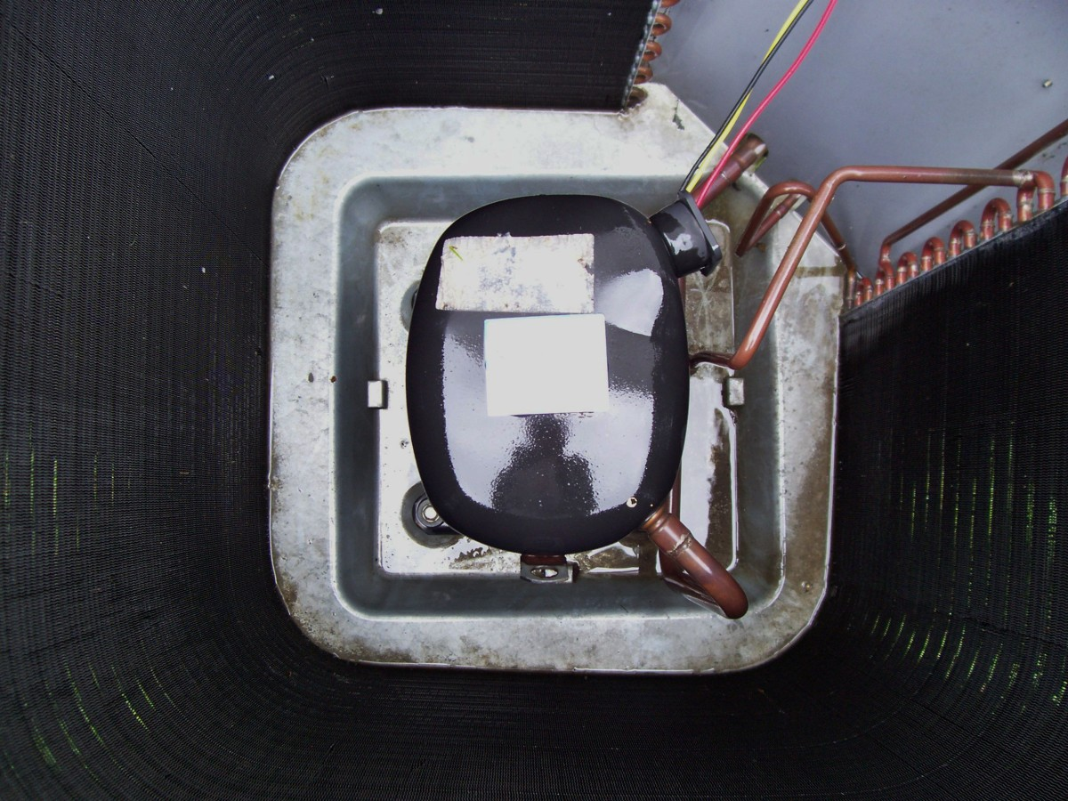 This is a top view of the compressor located in the center of the condensing unit. Other than cleaning your unit, you shouldn't really be in here but do note if you are, this may be very hot. Especially some of the copper lines attached to it.
