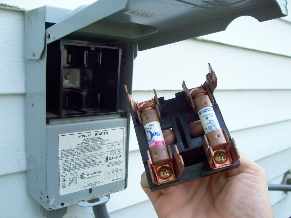how to diagnose and repair your air conditioner a c capacitor on this particular disconnect pulling the handle cuts the power and exposes the fuses