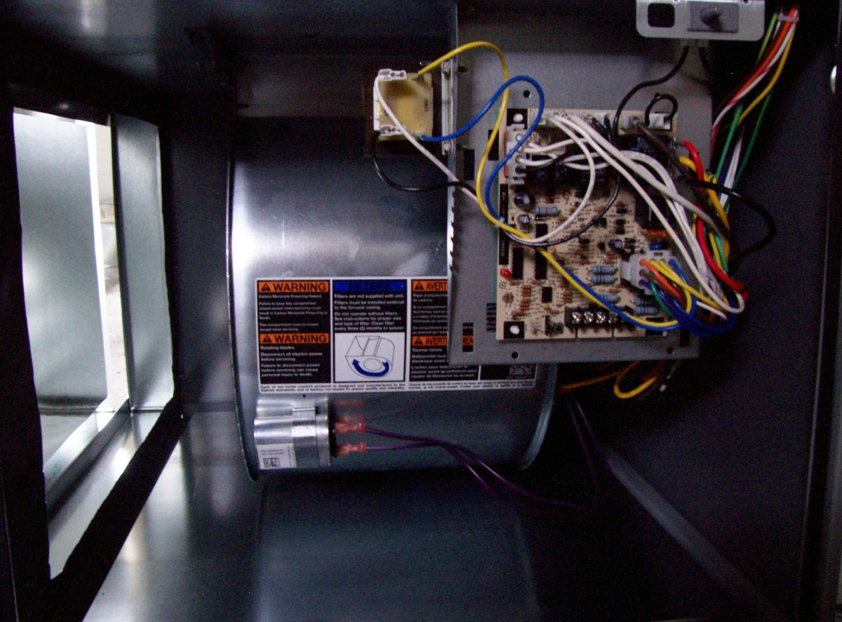 The circuit board you see here is mounted to a metal bracket behind it. The bracket is mounted to the unit with just a couple screws. Take the bracket loose from the furnace, not the board from the bracket.