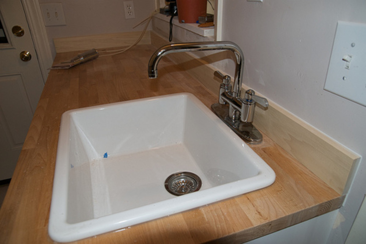A free-standing or integrated laundry sink will make hand washing much easier.