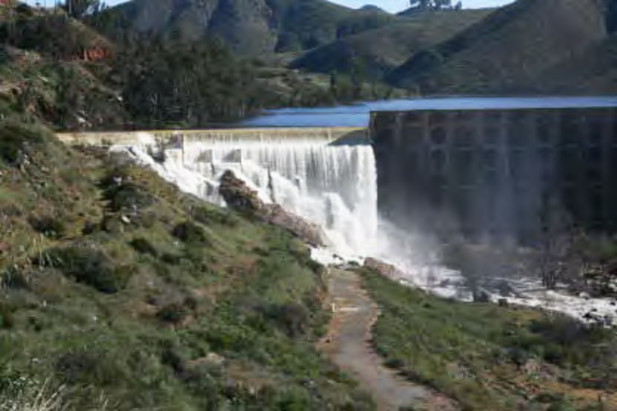 Concrete-lined dams create sheets of shallow water that heat up and evaporate, instead of sinking into the ground to refill the aquafir.