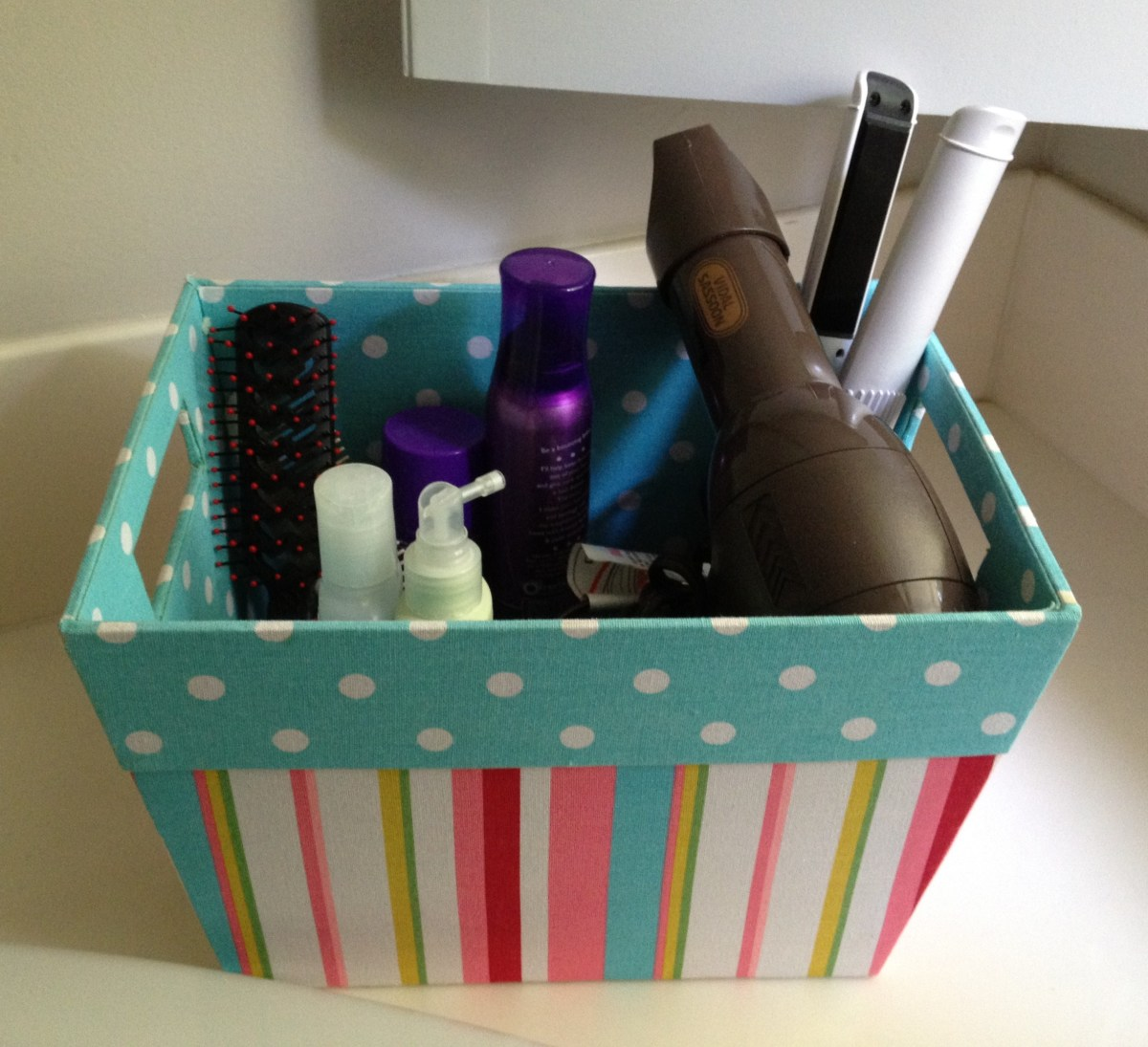Place hair styling supplies in a fabric organizing box and store under the sink.