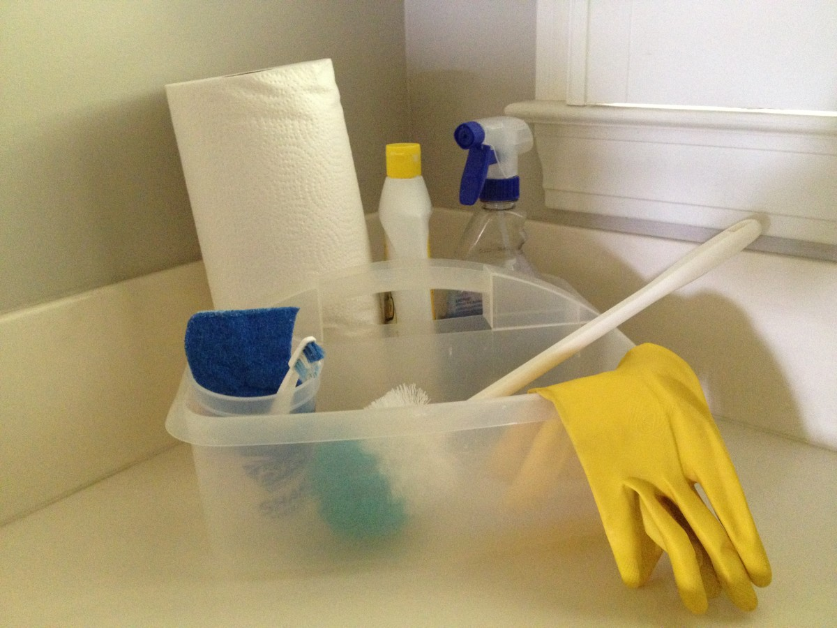 A cleaning caddy filled with cleaning supplies for the bathroom