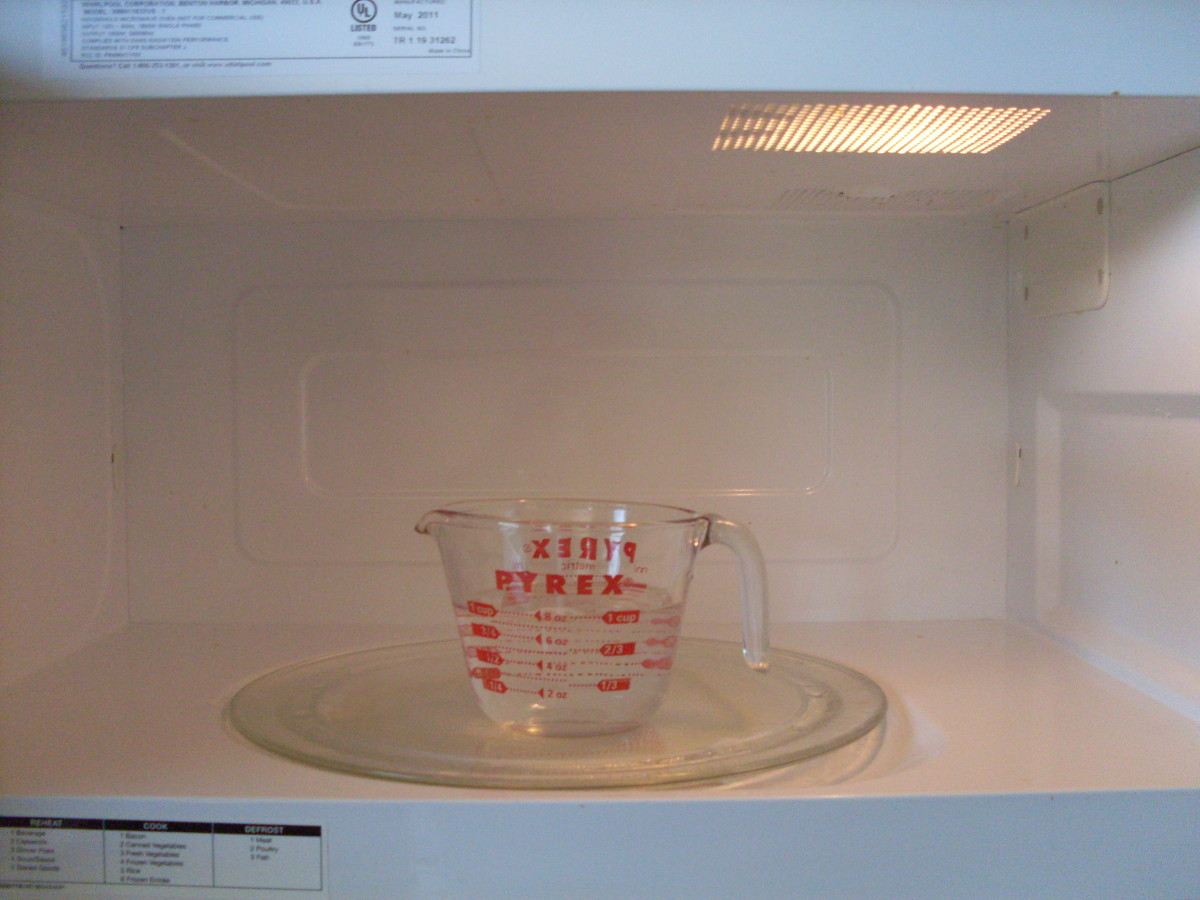 Mix water and vinegar together in a cup, boil for two minutes in the microwave, let sit for fifteen, then wipe down.
