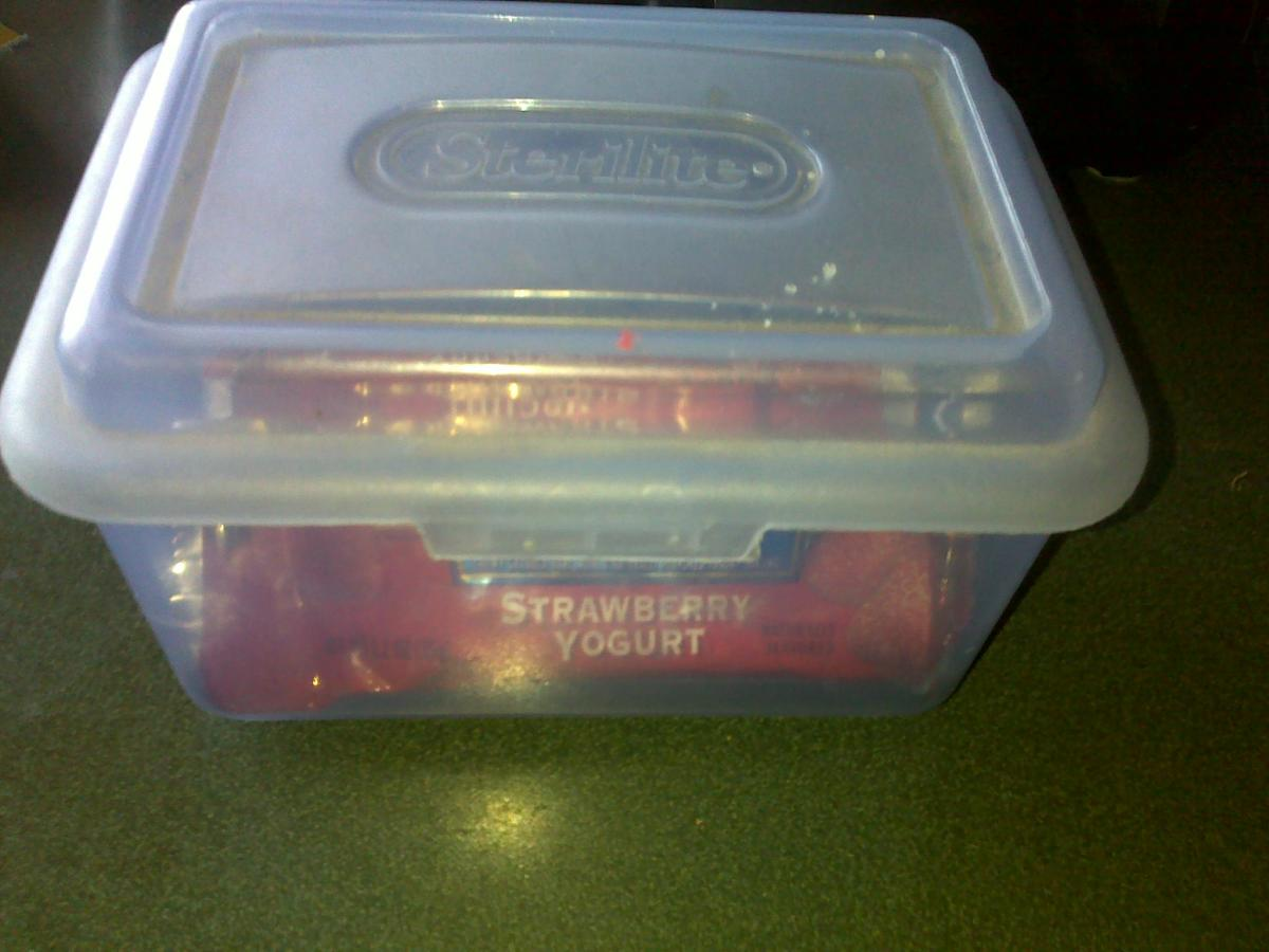Storing granola bars in a container with a lid is better than storing them in the box from the store.