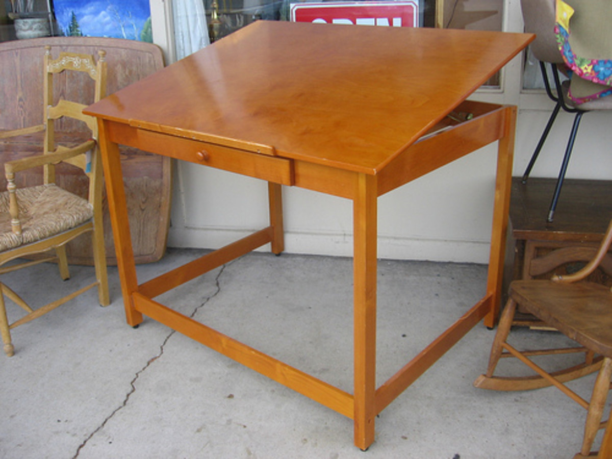 Drafting tables come in variety of designs, but always feature an angled work surface.