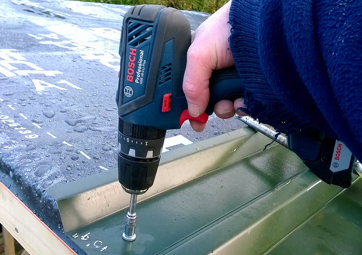 18 volt Bosch professional series cordless drill, used here for driving TEK screws to attach metal roof cladding.