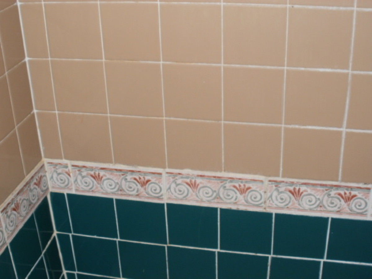 Porcelain tile cleaned with vinegar.  Stubborn areas required a paste of baking soda and water.
