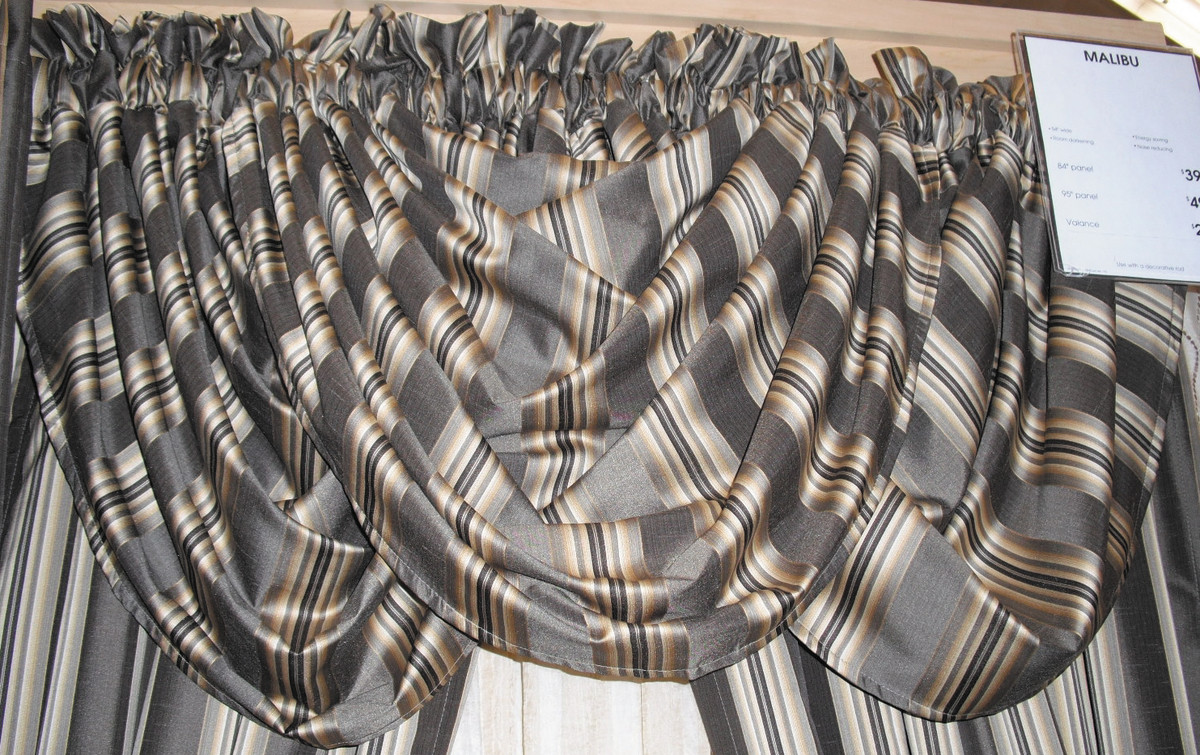 The graceful drapes of a swag valance suit a traditional room.