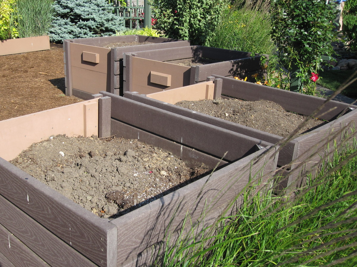 Compost bins are tucked into a corner of the test garden and screened with prairie grasses.