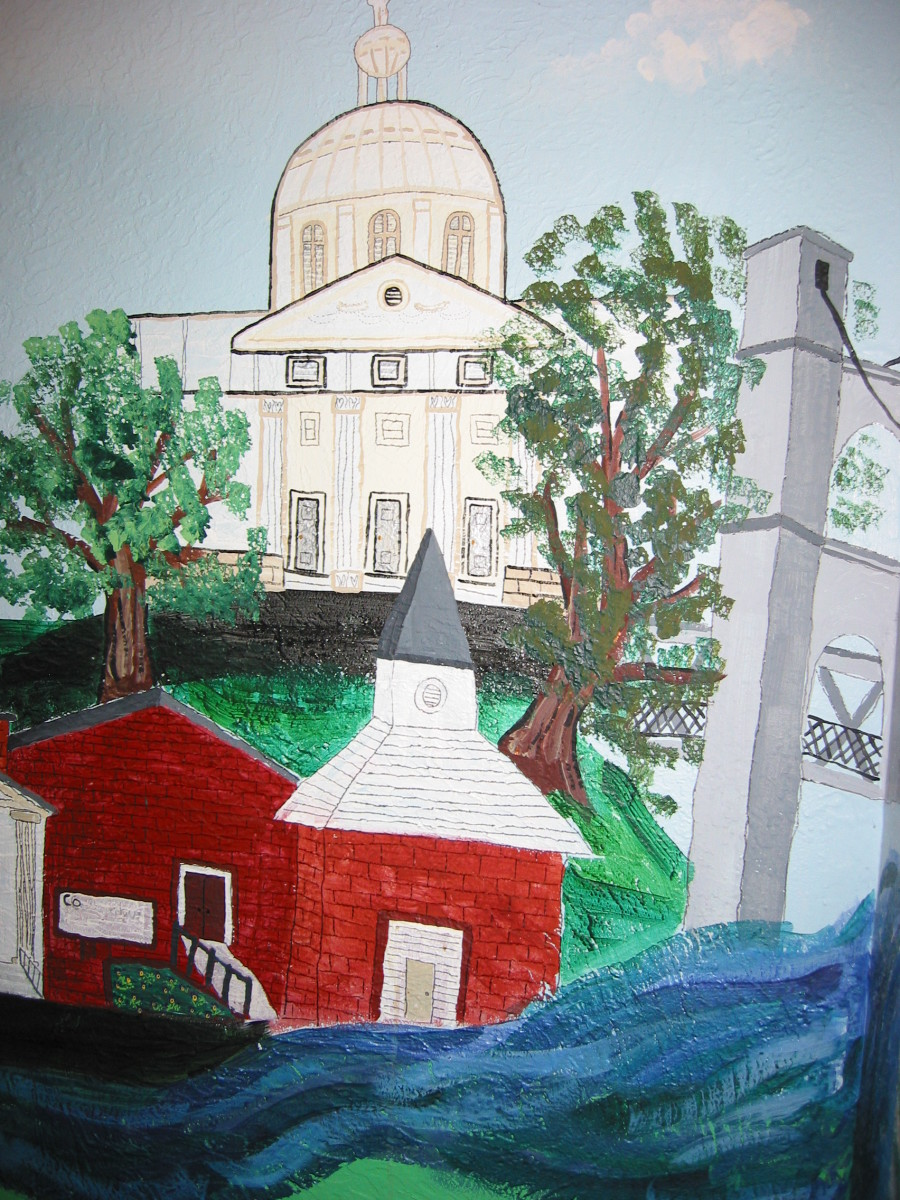 City wall murals work best with interesting buildings like this city hall and church.