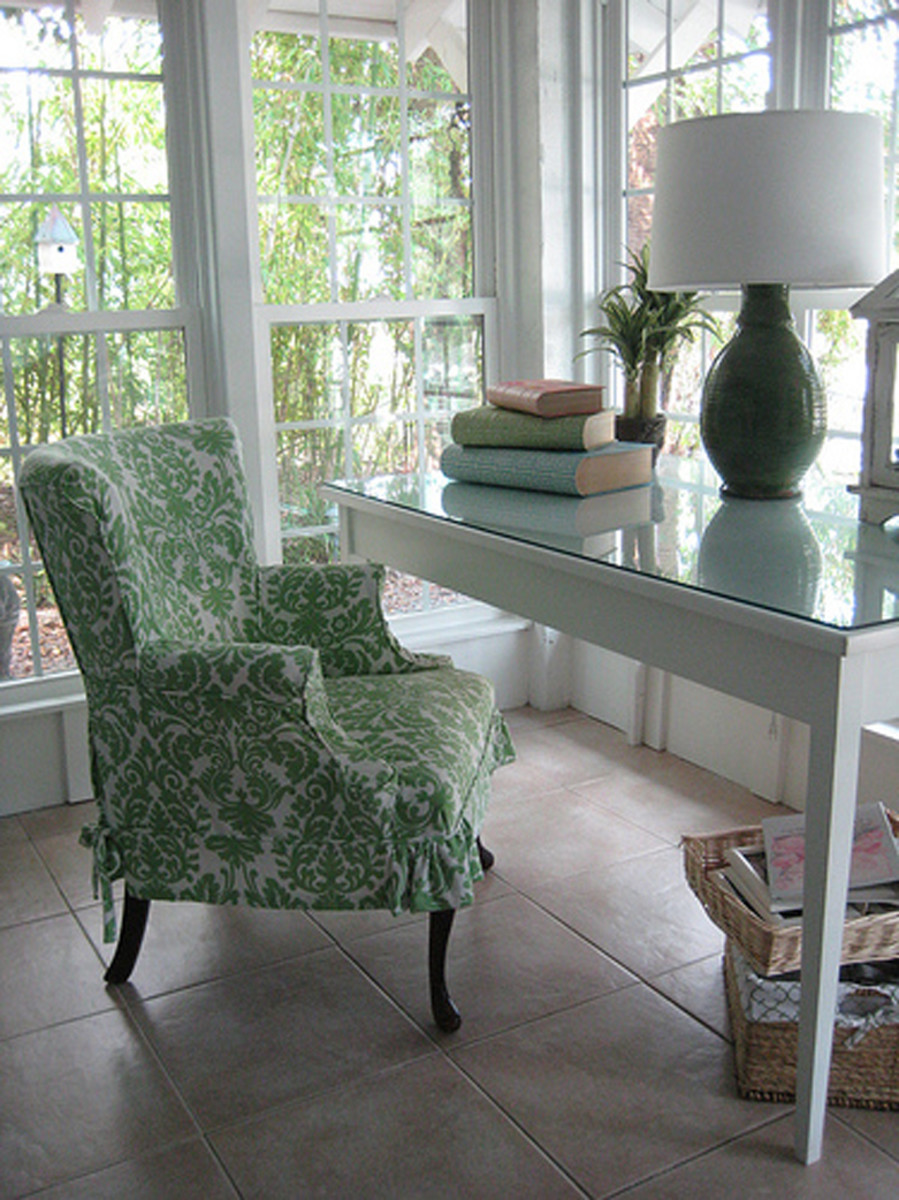 This slipcovered chair and clean white painted desk create a garden cottage feel.