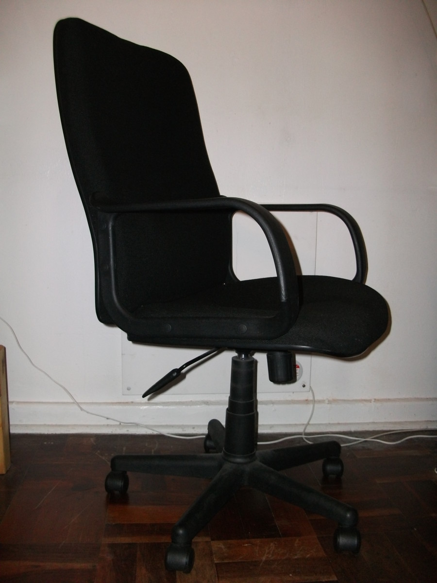 A midback chair with no headrest.