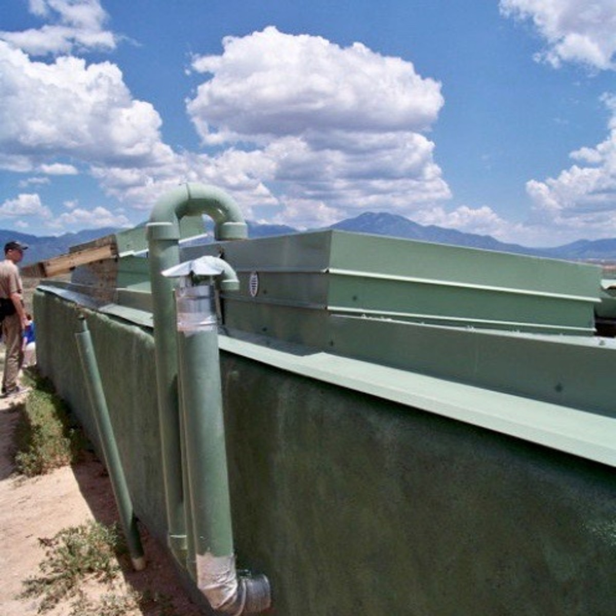 Solar Water Heater - The pipe leading to the bottom of the solar panel supplies it with cold water. The pipe emerging from the top of it carries heated water down to a hot water tank inside the house.