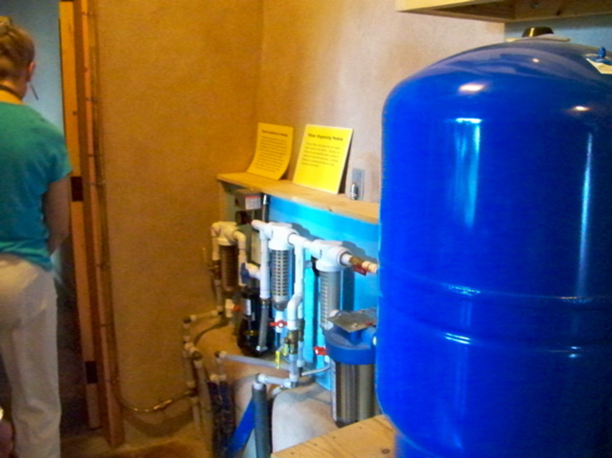Rainwater Purification System - These filters assure that rainwater meets local drinking quality standards. Water is purified as it moves from the cistern to a pressurized holding tank.
