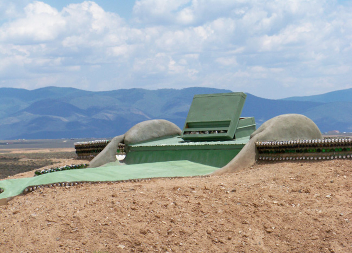 Earthship Roof - Earthships are built into small hills, with the window side facing south and the other sides insulated by earth.