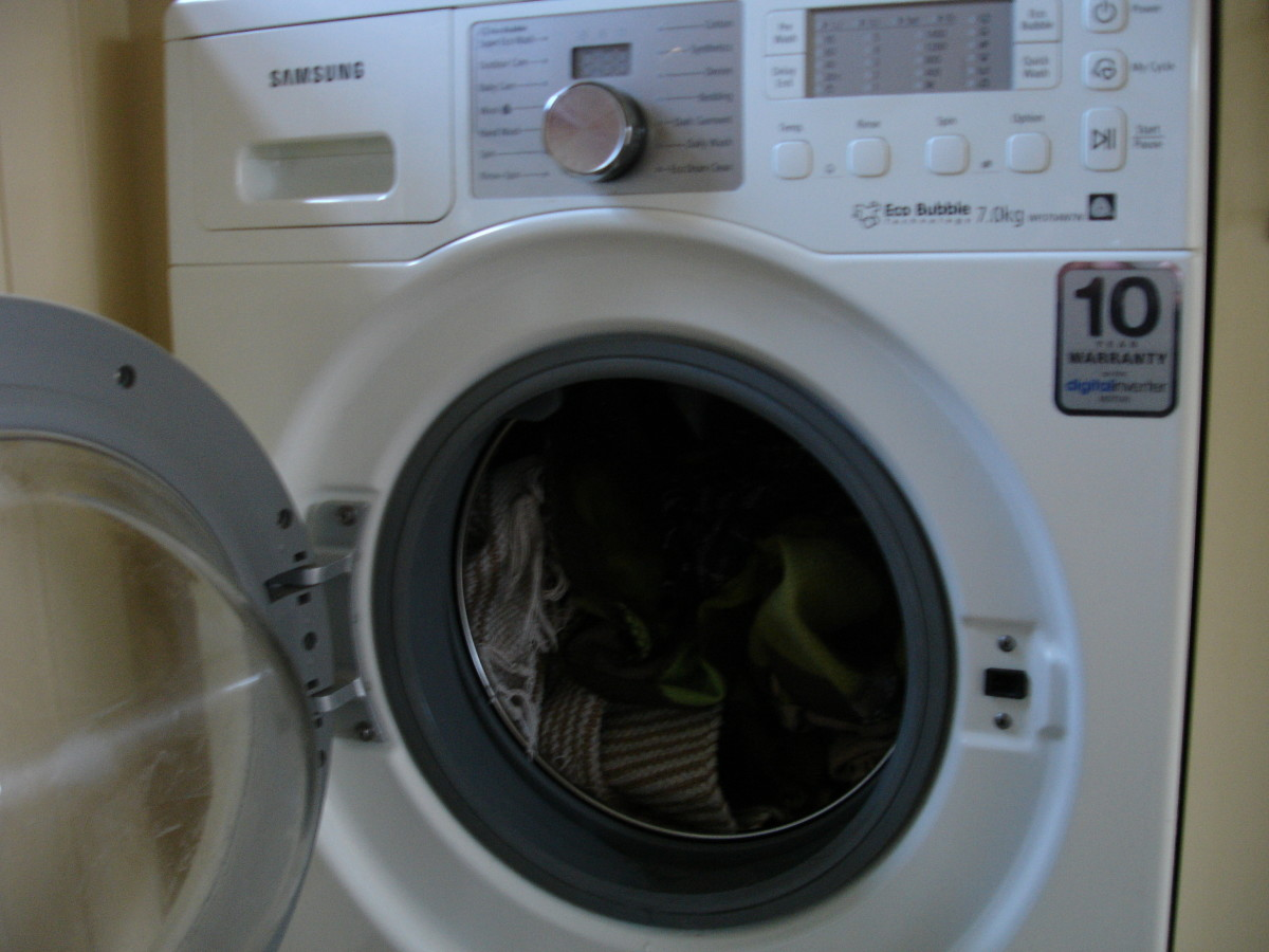 Another shot of Samsung washing machine with door open and stuffed full of dog blankets!