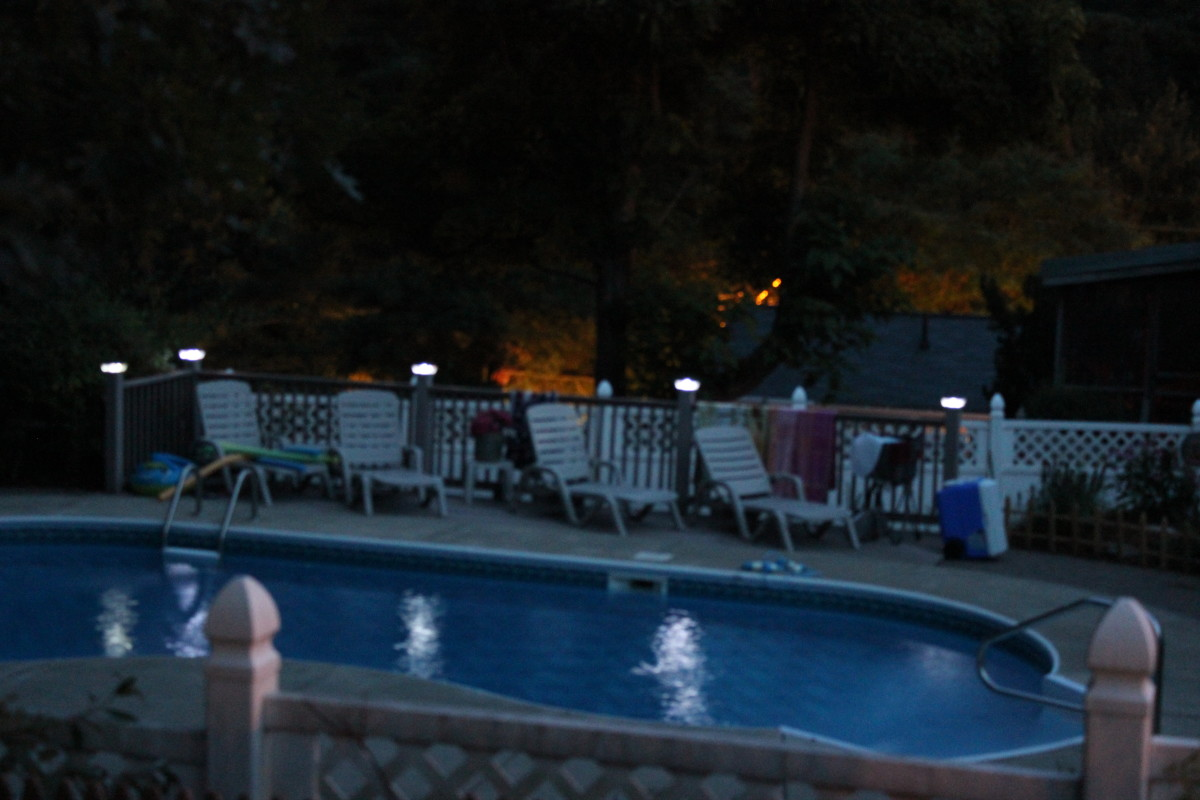 LED solar lights along the side of a pool, they don't really light a path, but put a twinkle on the water.
