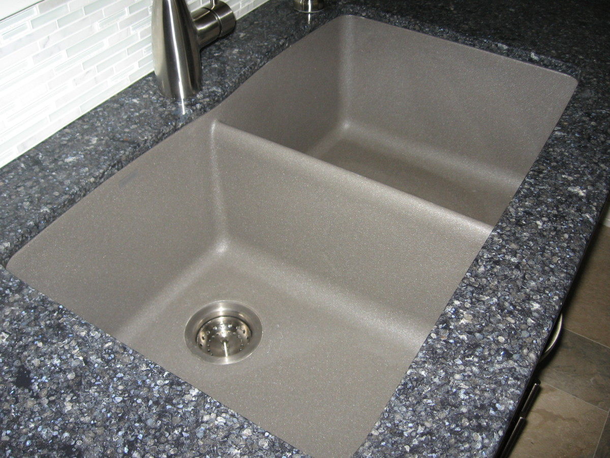 My sink is metallic gray, which provides an accent to the darker, grayish-blue quartz.