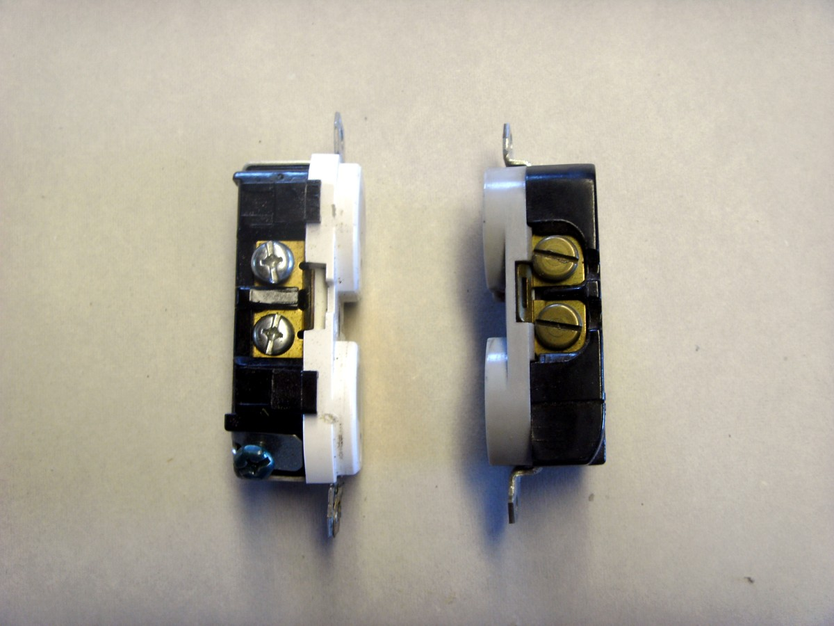 The outlet on the left is showing the silver screws (white wire) along with the green ground screw near the bottom (bare wire).  The one on the right is showing the brass colored screws (black wire).
