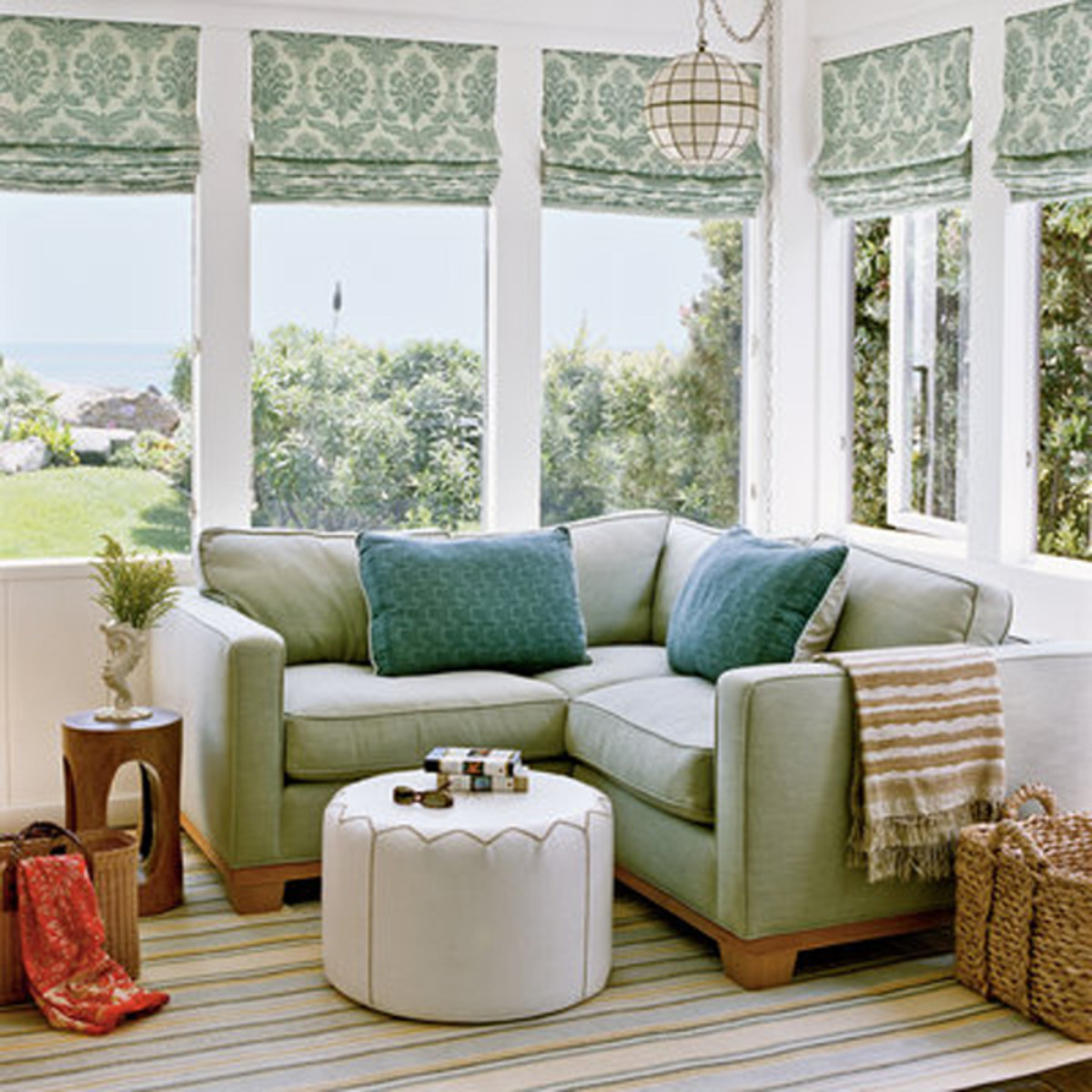 Light and airy fabrics and furnishings give a cottage a beach feel.