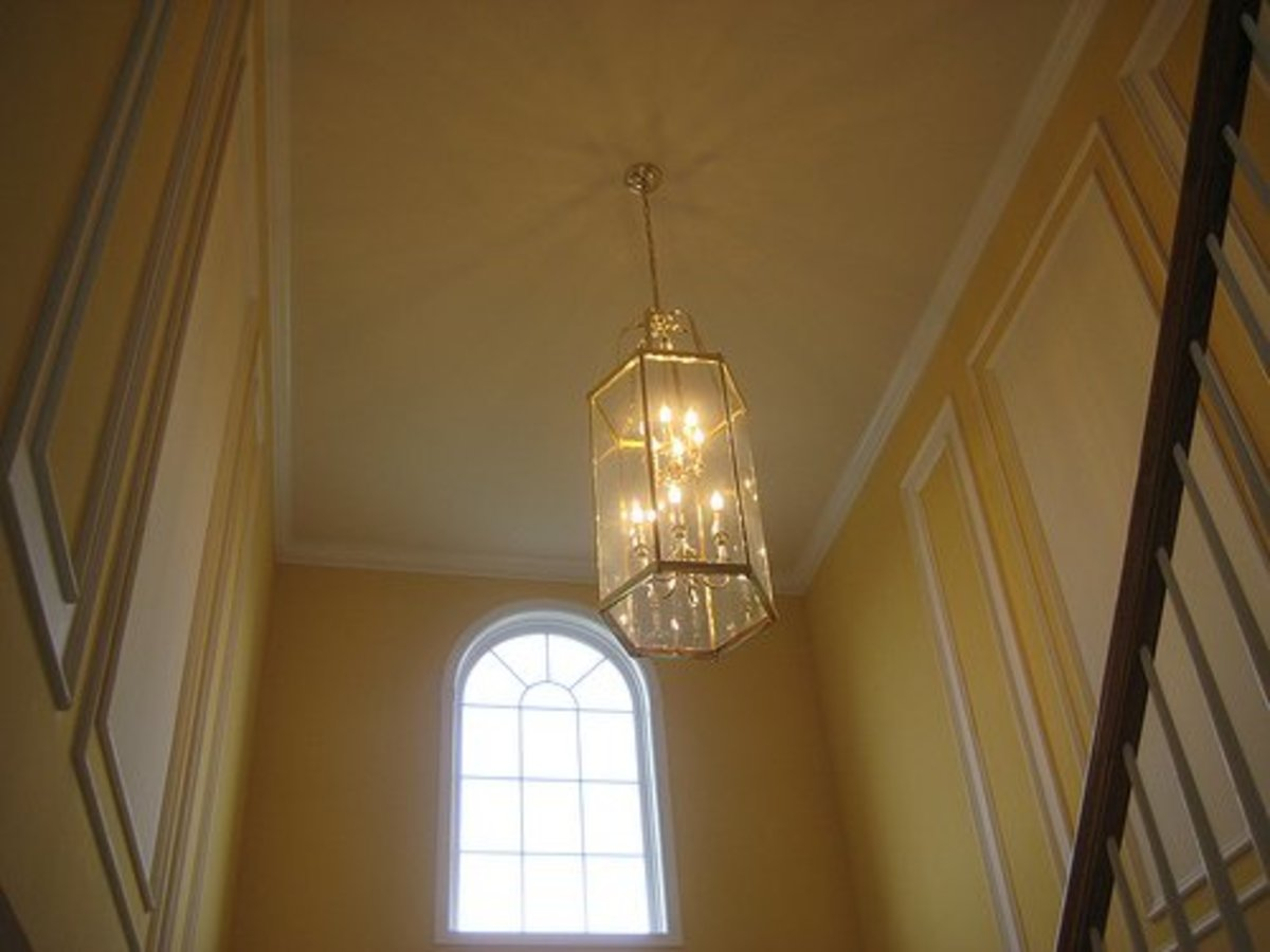 Architectural features like bannisters, molding, and stairs often play into the line element of room design.
