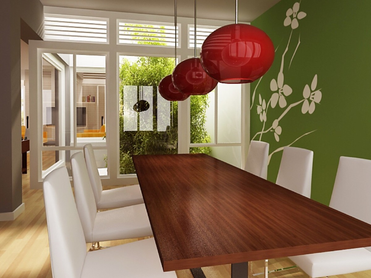 In this room, the long, rectangular dining table mirrors the shape of the space and instills a sense of unity, while the round, hanging light fixtures provide contrast and visual interest.