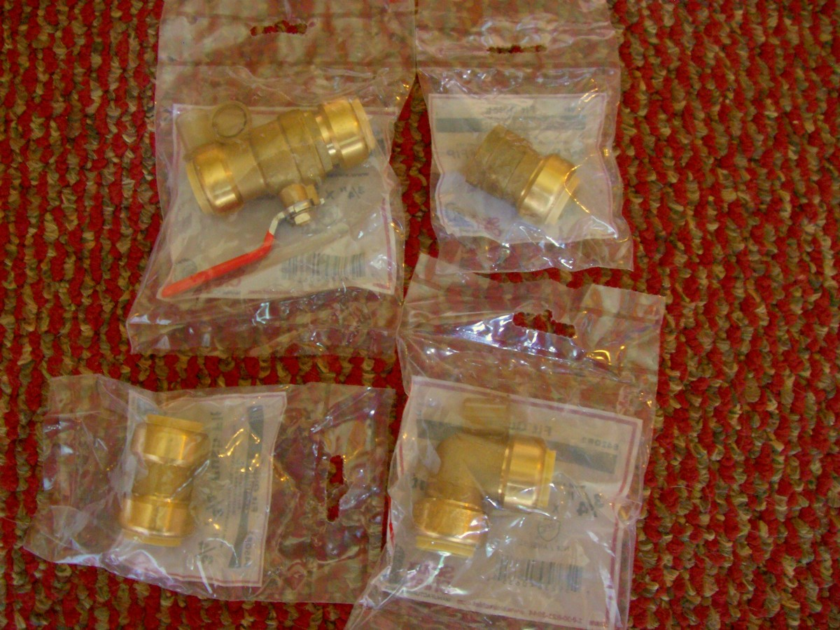 Here you have a push fit valve (top left), coupling (bottom left), elbow (bottom right) and adapter (top right).