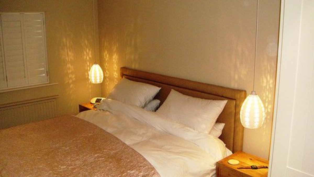 Bedside pendant lights save valuable nightstand space.