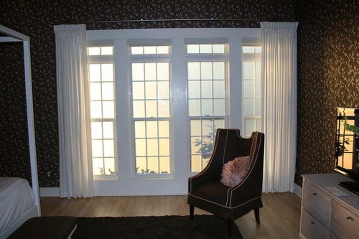 See how curtains soften the lines of these bedroom windows?