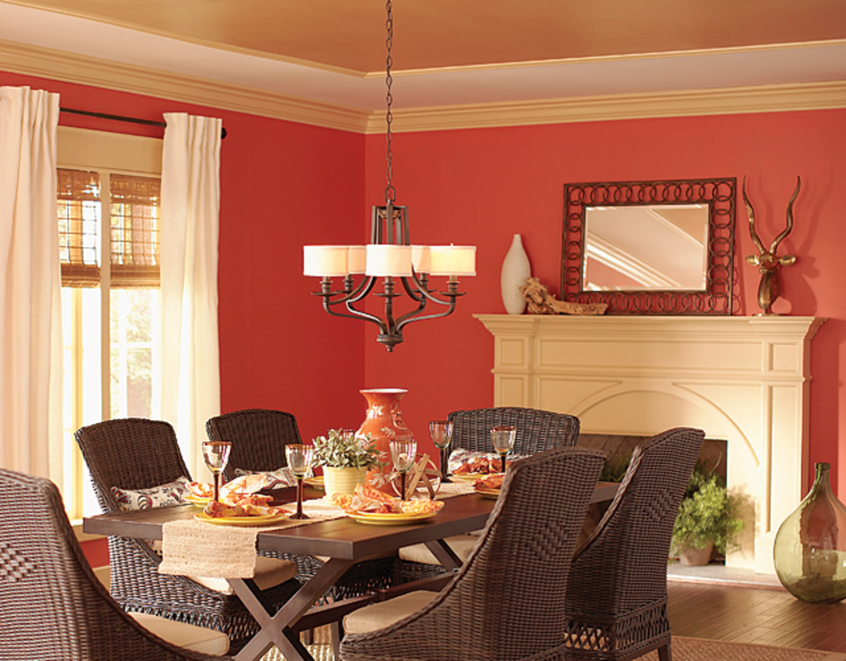 This ceiling features gold paint and brings the color down onto the wall with crown molding to visually increase the ceiling height.