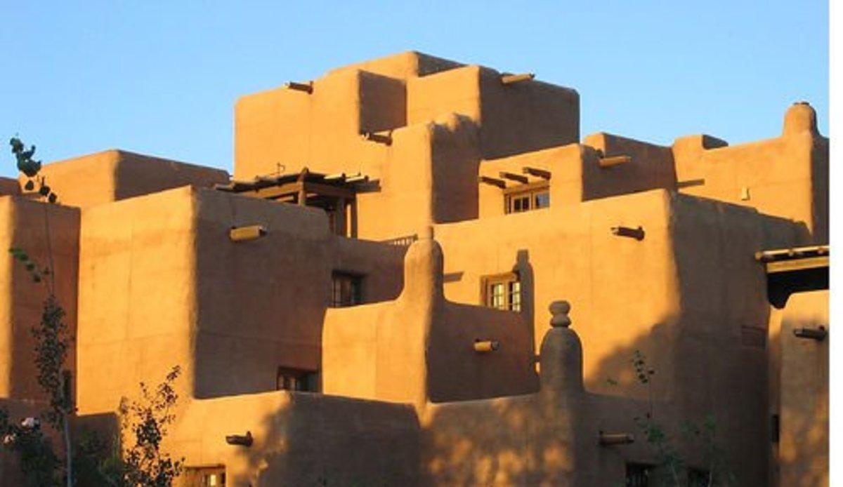 Adobe construction and vigas exemplify the Pueblo revival style.