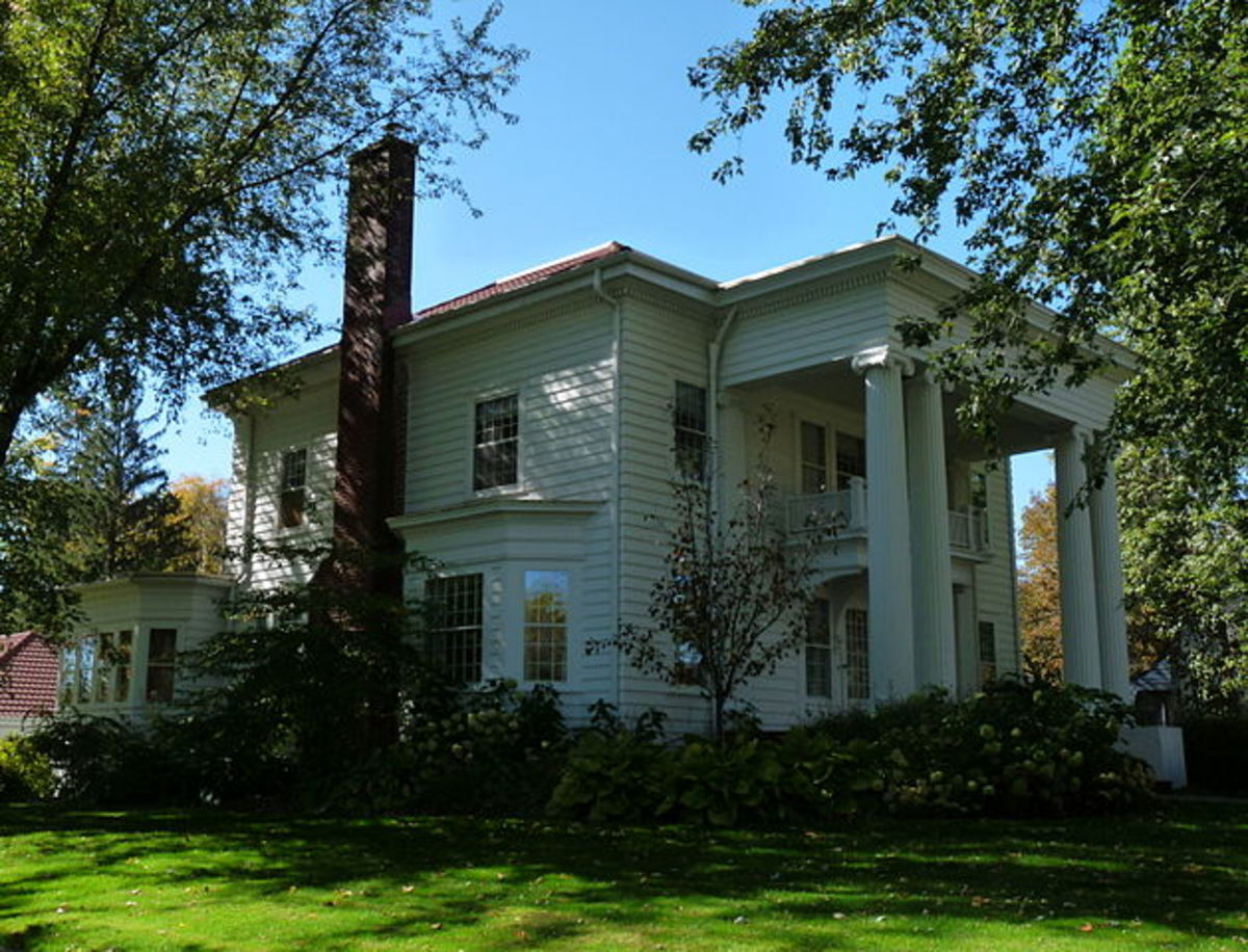 Note the tall porch, columns and dentil molding of this Neoclassical Revival home in Wisconsin.