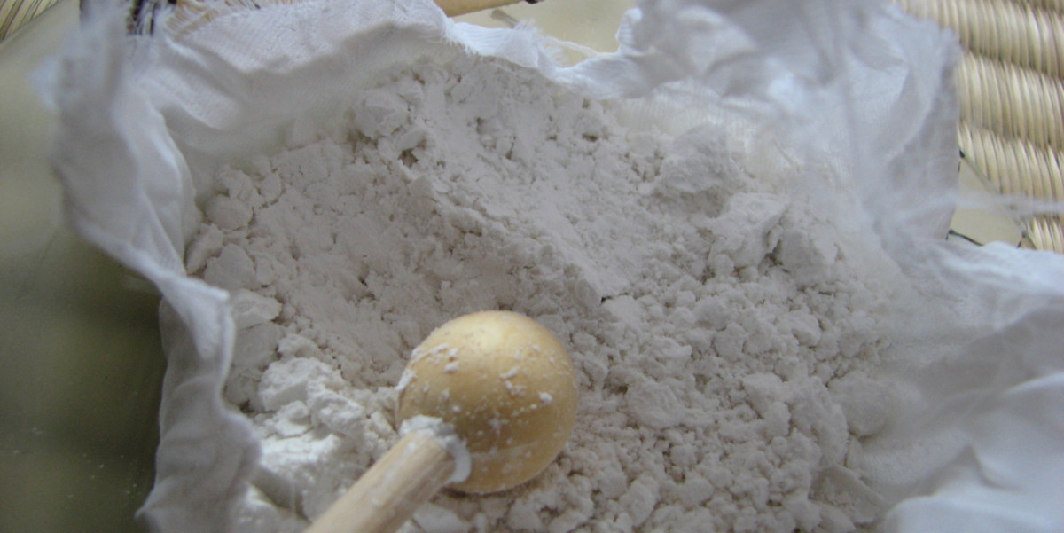 Inside the uchiko - stone cleaning powder and tapping ball/stick, wrapped in a white silk cloth.