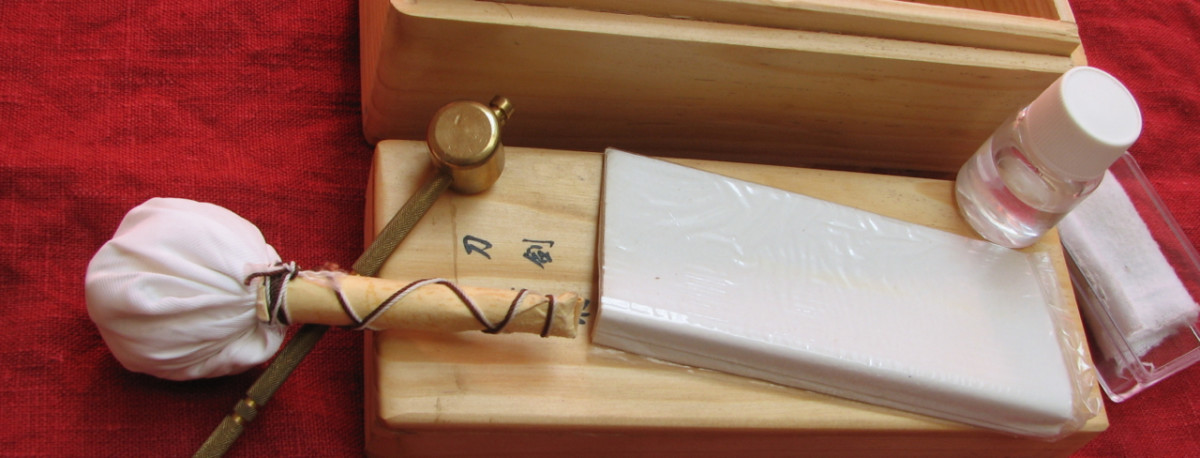 My sword cleaning kit - uchiko, brass hammer, nuguigami, choji oil, oil cloth.