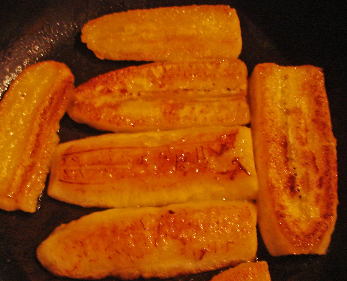 Pan-fried slices of mature plantain, a sweet treat that goes well with almost any meal.  They are commonly served with breakfast in Central America.