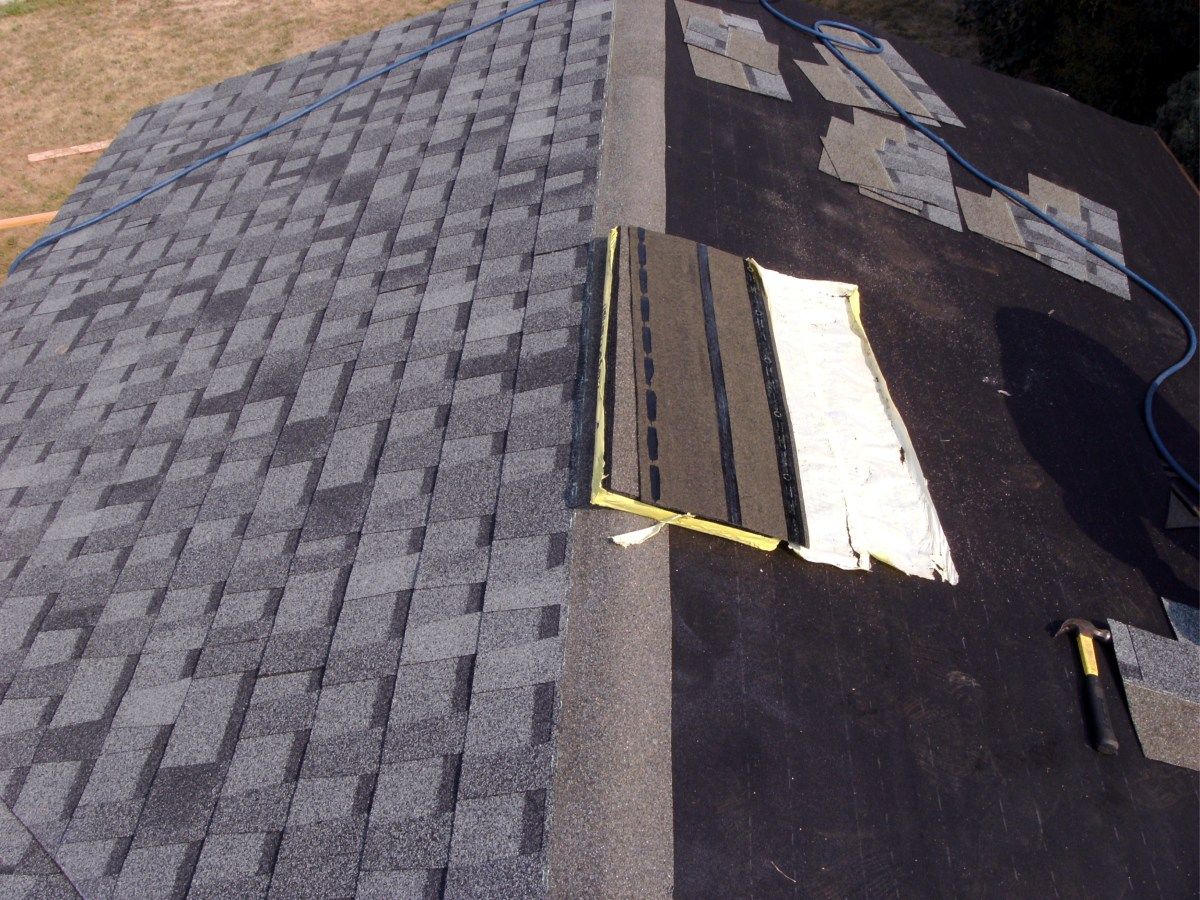 The shingles were removed from the right side here, leaving a good layer of felt.  It does not need replacement.