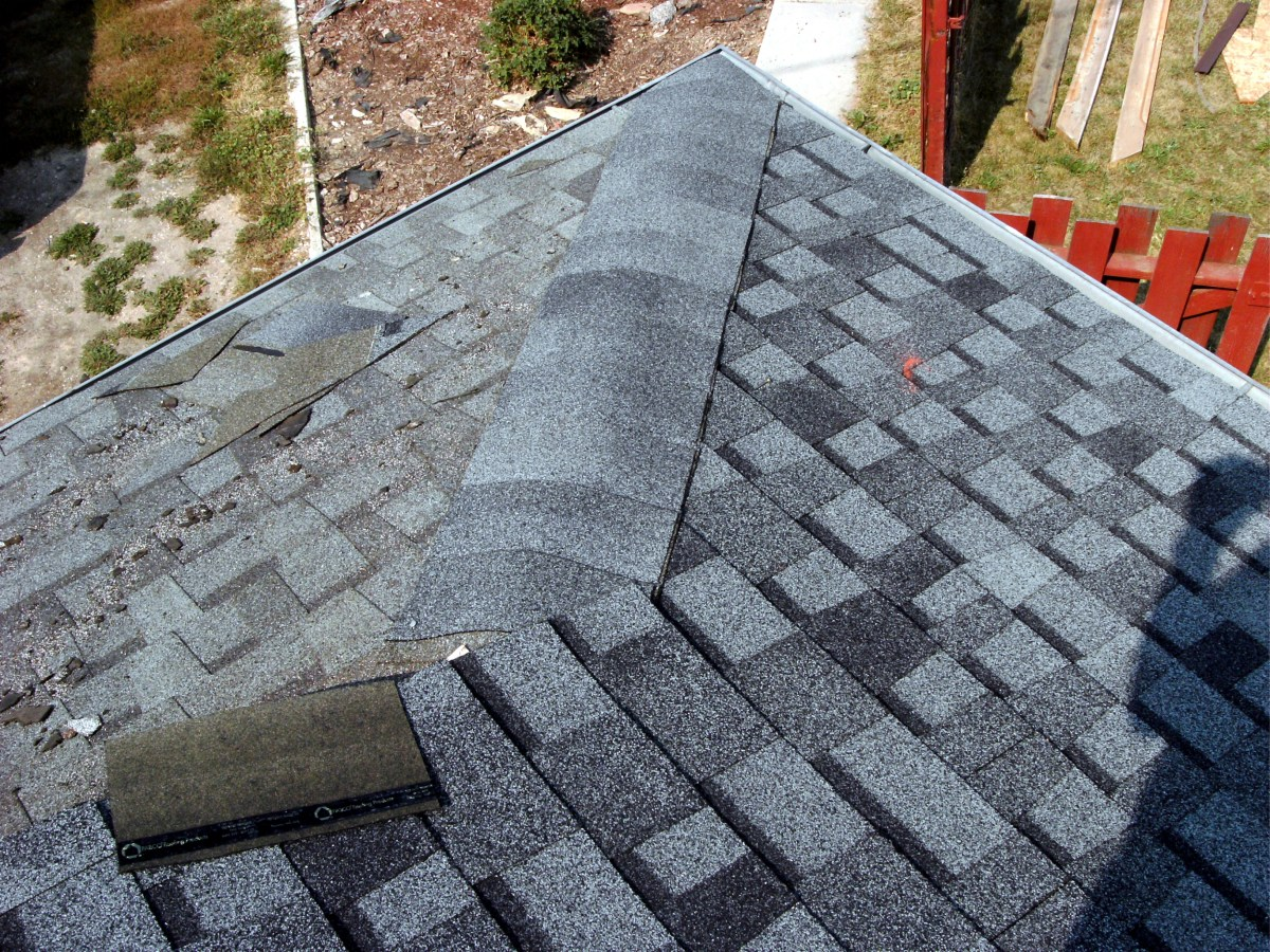 This hip is done the same way that the top ridge is, while also making sure that rainwater has no way to get under the top shingle.