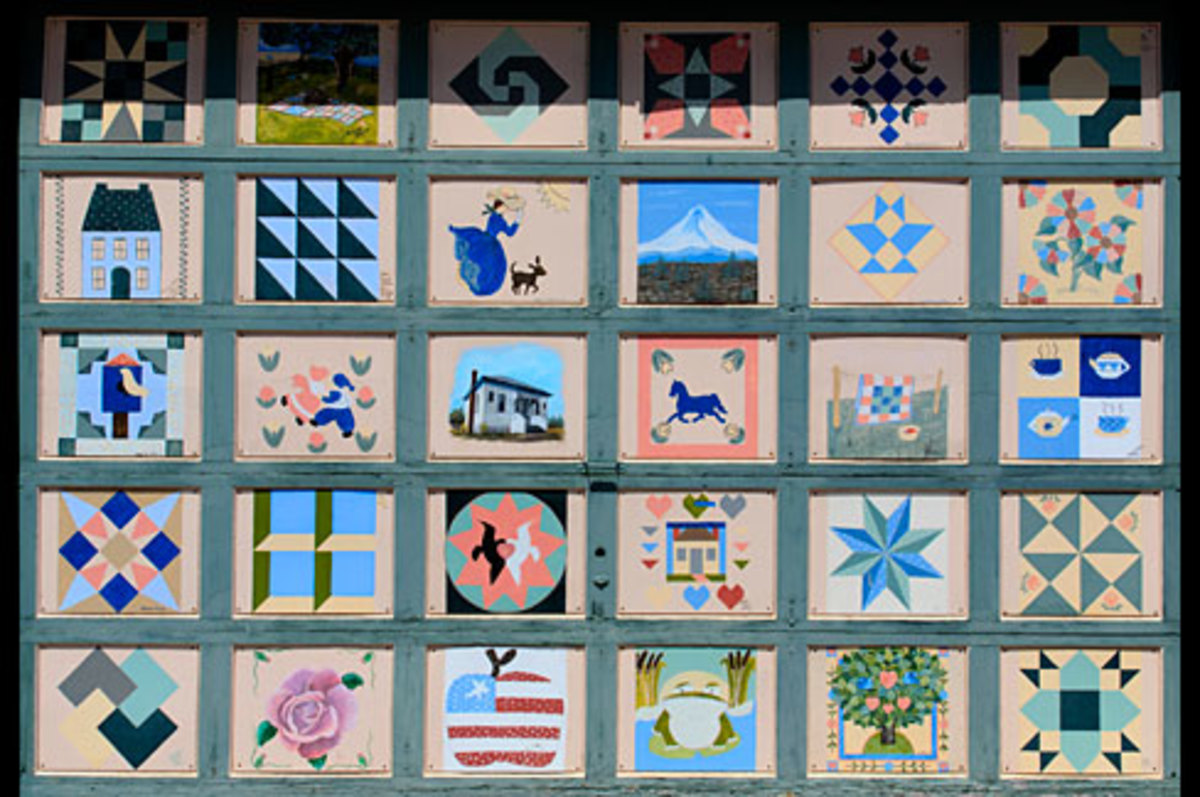 Once you have filled your house with quilts, you can decorate your garage door by painting with quilting motifs.