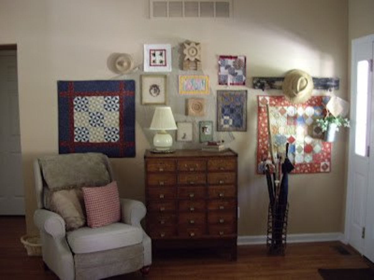 An arrangement of small wall quilts grace this beautiful foyer.